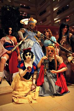 (Oh man, how fun/creepy would it be to do a theme costume w/twisted princesses, especially if it went with the theme -- Snow White's apple could have fake razor blades sticking out of it with blood dripping down, Pocohontas with a blood-stained tomahawk, etc.)