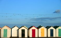 Photo about Traditional British seaside beach huts, photographed at Torquay, England. Image of holiday, yellow, torquay - 1131237 Seaside Art, Seaside Theme, Seaside Beach, Beach Huts, British Beaches, British Seaside, British Summer, England Beaches, Hotel Deals