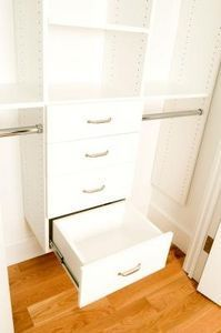 This closet organization system includes drawers and double hanging space. Small Closet Organization, Laundry Room Storage, Closet Storage, Organization Hacks, Attic Storage, Bedroom Organization, Organizing Ideas, Kid Closet, Closet Bedroom