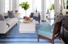 """Of the new living space, Cassie says, """"My husband had told me that he didn't care about anything except a comfortable couch. We're lounge-y couch people. Thankfully, this new one is so comfortable. And the whole space feels so much more open."""""""