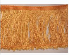 """Our 100% Rayon Fringe can be used for sewing or crafts, costumes, lampshades, draperies, and other home decor items Available in 2"""", 3"""", and 4"""" Color: Flag Gold"""