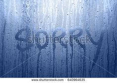 Conceptual sorry word handwritten message on the rainy glass window background. Blue color tone used. Horror Themes, Handwriting, Photo Editing, Royalty Free Stock Photos, Window, Neon Signs, Messages, Words, Glass