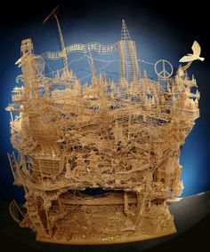 """Thirty-five years ago, Scott Weaver, started working on his wonderful sculpture made of  toothpicks. After 35 years, 100,000 toothpicks, and 3,000 hours of work, the sculptor completed this amazing sculpture of San Francisco, he calls """"Rolling Through the Bay"""". The sculpture consists of well-known historical sites and symbols of San Francisco."""