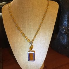 GivenchySUPER REDUCED Vintage 70's Necklace Beautiful Amber cut beads with an amber and silver framed pendent. Very chic. Givenchy Jewelry Necklaces