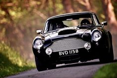 Aston Martin DB4 GT, what's that coming over the hill??? Fantastic photograph!