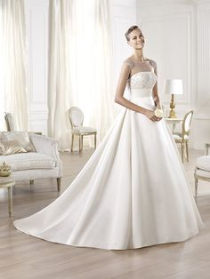 Oderi wedding dress from the Costura 2014 collection with a bateau neckline for an elegant bride. Pronovias 2014.