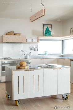 Don't feel limited by a small kitchen space. Get design inspiration from these charming small kitchen designs. Mobile Kitchen Island, Portable Kitchen Island, Kitchen Island On Wheels, White Kitchen Island, Kitchen Islands, Kitchen Trolley, Modern Kitchen Cabinets, Kitchen Cabinet Design, Kitchen Layout