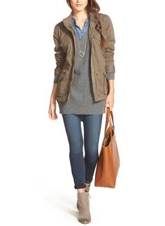 Pairing an olive jacket with an oversized sweater, denim and booties for a quick and easy on-the-go look.