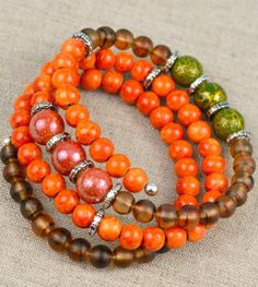 The Autumn Memory Wire Bracelet is a fun and fashionable DIY accessory that is perfect for the fall season.