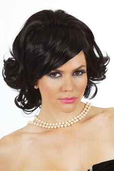 This is a gorgeous 1950's Bouffant with soft curls, beehive and side swept fringe. Suitable for Jackie Kennedy style. www.thewigoutlet.com.au