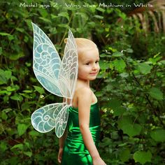 Here we have an in-stock pair of Tinkerbell / Periwinkle Costume Fairy Wings. These are ready to ship and will be posted 1-2 working days after youve placed your order. Measurements for these wings are Width 6 inches Height 12 inches The mannequin is a Uk size 8/10 Bust – 33inch