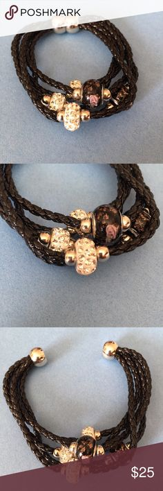 NWT Swarovski Crystal/Leather bracelet NWT strappy leather black bracelet with elegant Swarovski Crystals and shimmery beading. This goes great with nearly any outfit. Magnetic clasp closure. Jewelry Bracelets