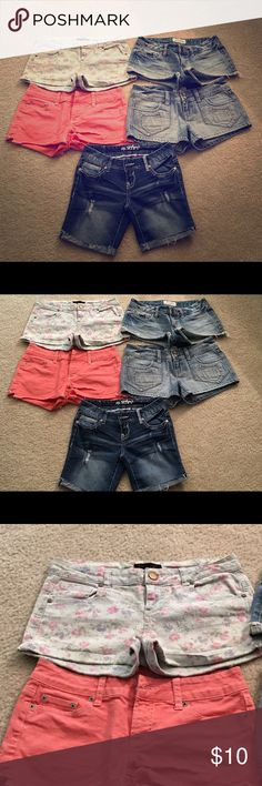 Bundle of women's mini shorts 1 pair short & sexy series shorts size 0 cuffed leg, destructed 5 pocket shorts; 1 pair fire Los Angeles 5 pocket floral cuffed leg mini shorts size 3; 1 pair Aeropostale 5 pocket frayed leg mini shorts size 1/2; 1 pair Aeropostale 6 pocket double button mini shorts size 3/4; 1 pair peach colored American Eagle 5 pocket frayed leg mini shorts size 4.  All in good condition. Shorts Jean Shorts
