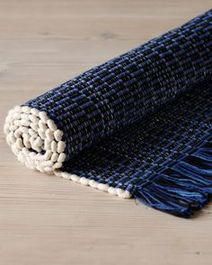 The oxford rug is a 100% cotton hand loomed rug made in Pennsylvania. It is an allover blue, white and black pattern with fringe. Soft underfoot and yet sturdy enough to handle heavy foot traffic. * h