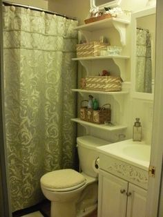 Small Moments: Bathroom Reveal!  A very small, but cute, bathroom...with shelves and baskets for storage