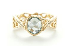 """Trend tracking: uncommon bridal. This 18-karat yellow gold """"golden gate"""" band with a 1-carat rose-cut blue-green sapphire is by Dawes Designs. It retails for $2,750."""
