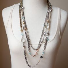 """ORIGIN : NY, France For the girl who loves to be One-of-a-Kind. These artisan pieces are crafted by Tamara personally. Mixed metal chain (over 9 different hand selected finishes) hand wrapped with crystals, rhinestones & vintage brass findings. Length: 32"""""""