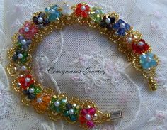 Side 1 of reversible bracelet faceted bicone crystals, glass pearls, gold seed beads, magnetic clasp $35.00