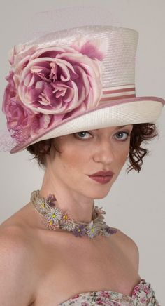 Here's another hat I like for a bride. AND you might wear it again after the wedding is over. More fashion tips at: http://www.boomerinas.com/2013/12/28/wedding-hats-and-veils-for-brides-over-40-50-60/