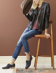 A leather jacket adds cool girl appeal to this casual-chic ensemble, styled with a fedora and oxfords to complete the city girl look.
