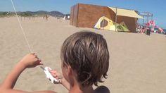Kids Flying Kites on Beach at Playa Brava in Spain