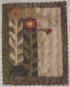 This would look great in wool.  Love the stitchery on the flowers...