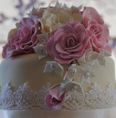 Cream lace wedding cake with pink roses, cream open roses  white hydrangea by the Handmade Cake Company