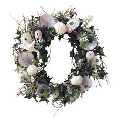 Add a touch of coastal charm to your entryway or three-season porch with this lovely wreath, showcasing a cluster of shells and sea life.  ...
