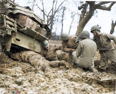 US 9th Army Troops are filmed recovering an M4 Sherman Tank from the Rhineland mud in the winter of 1944.