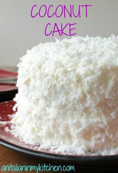 Coconut Cake, a delicious soft, moist cake with a creamy cream cheese frosting. Topped with coconut flakes, a perfect Christmas dessert. Coconut Desserts, Coconut Recipes, Just Desserts, Delicious Desserts, Coconut Frosting, Cake Recipes, Dessert Recipes, Moist Cakes, Savoury Cake