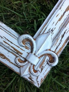 Add fleur de lis (or other symbol) to corners or top center of picture frames before painting (RM)