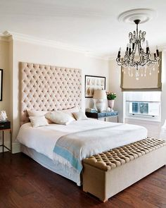 Luxurious bedroom with massive tufted headboard