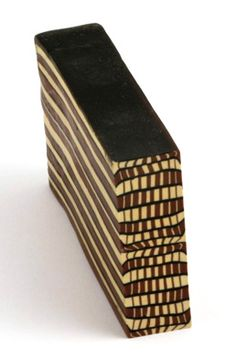 from polymer art archive, step blend cane by City Zen Cane. From this blog post: http://polymerartarchive.com/wp-content/czc-stepblendcane.jpg