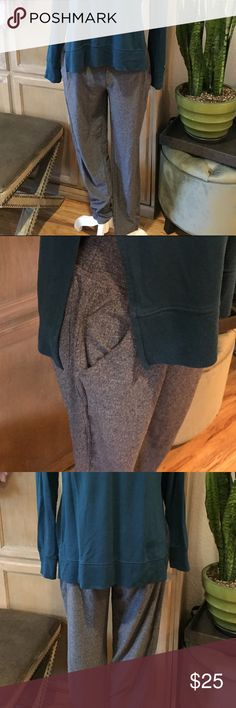 Champion M Grey Athletic Work Out Jogger Pants EUC These pants are a jogger fit (fitted to you, but more roomy than yoga pants). They are fitted at ankle like a skinny pant. They look great paired with an activewear too or to lounge around the house or run errands around town. They have pockets on each side and on the back on one side (what a great feature!)   Worn once, Excellent Used Condition Champion Pants Track Pants & Joggers