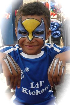 Wolverine Mask and claws painted by Wina Shelley of Party Picassos Face Painting; 312.316.7819