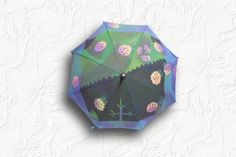 "this sunshade was made by Japanese wax resist dyeing brand ""poem nouveau"". http://poemnouveau.com/ ろうけつ染めでデザインされた日傘です。"