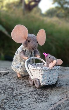 Needle felted little mouse, walking her baby in the stroller.