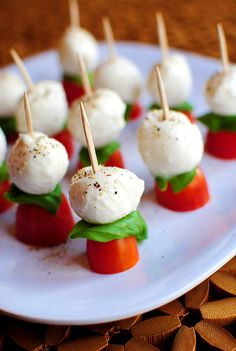 My Caprese salad on a skewer. Baby bocconcinni, cherry tomatoes, basil, leaves, cracked pepper. Served drizzled with balsamic vinegar and olive oil, or in a separate small bowl to dip in.