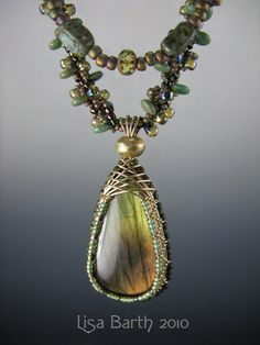 Here is  piece I did with a beaded necklace.  The stone is Labradorite and the necklace weave is Russian spiral.
