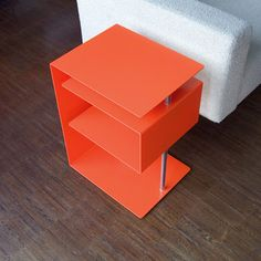 Pop modern side table. Designed by Murken Hansen for Radius Design, the X Centric End Table.
