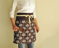 Reversible half apron - brown flowers and check. $42.00, via Etsy.