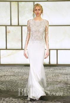 Gorgeous embellished long sleeves by @rivini | Brides.com
