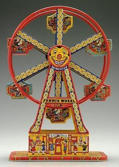 "Chein Hercules Wind-Up Ferris Wheel.  17"" tall x 10.5"" wide x 5"" deep. One of my favorite vintage tin toys.  May 2012"