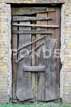 Boarded up wooden door to an old abandoned house Stock Photos , Old Wooden Doors, Photography Backdrop Stand, Photo Boards, Abandoned Houses, Backdrops, New Homes, Stock Photos, Clip Art