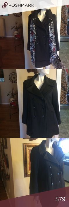 Calvin Klein Premium  Double Breasted Pea Coat Classic and comfy designer black pea coat that is lined and has side pockets! Measures 28 inches from neck to hem, 18 inches from pit to pit and sleeves measure 22 inches from shoulder down. Worn but in excellent condition! Wool, polyester and Cashmere mix. Calvin Klein Jackets & Coats Pea Coats