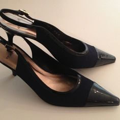 ST. JOHN Elegant Slingback heels Simply classically elegant and timeless ..patent leather trim and cap toe.. A great work shoe but also beautiful with black evening attire.. Made in Spain..pre-loved in EUC St. John Shoes Heels