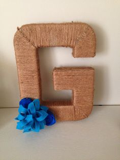 DIY large letter wrapped in twine and felt flowers. Made by Krystle
