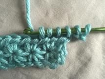 How to Crochet Star Stitch: Crochet Star Stitch: Draw Up Three More Loops