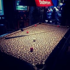Yes I can see this in my woman cave hehe RE-POSTED this for you Lindsey Ralston OMG Leopard print pool table! (at Newtown Hotel)