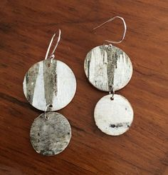 Natural birch bark disc earring with Sterling silver ear wires that Is hand made. The birch trees are natural from a fallen tree in the woods of